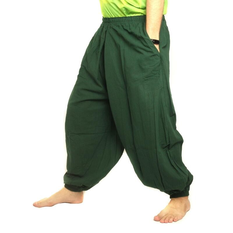 With hypnotic swirls of bright green buzzing about a black background, jungle green Honey Hive harem pants are ideal for moving intensely to infectious grooves. With a deep pocket, perfect for keeping treasures close to kinetic bodies, and light-as-air fabric that flows like the wind, these Thai harem pants are ideal for free-spirited festies.