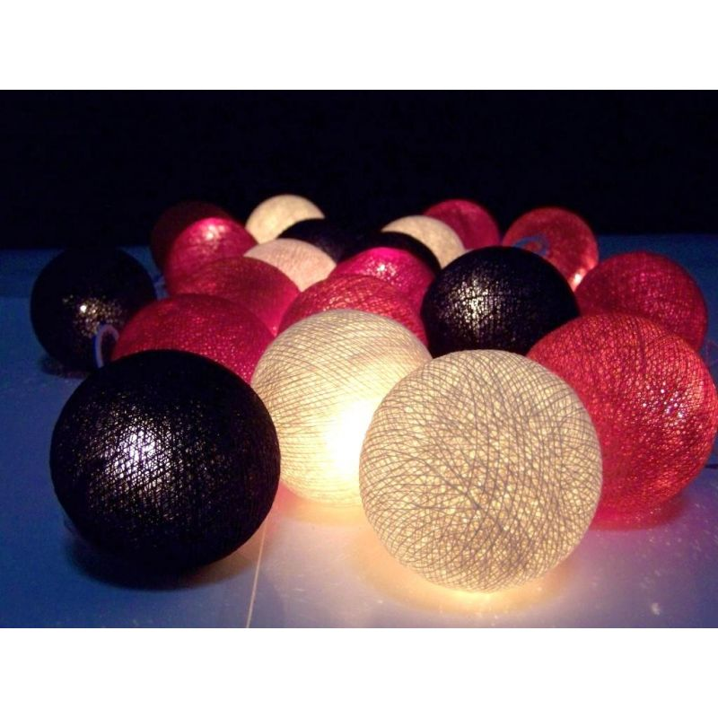 Christmas lights made of cotton balls, black red mix